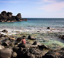 Small boy watches the waves by AdamRussell