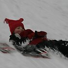 sledding in the snow by KSKphotography