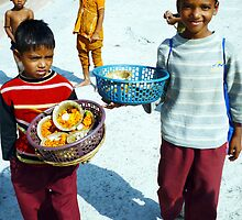 Boys selling puja in India. by wehavegrown