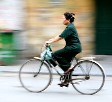 Bicycle woman in Hanoi, Vietnam. by Phil Bower