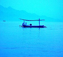 Blue boat on a blue sea by Michael Brewer