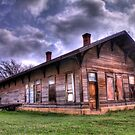 Kopprel Train Depot Under Stormy Skies by Terence Russell