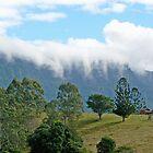 Cloud on the rim. by Graeme  Hyde