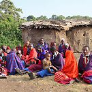 Maasai Women and Children with House by Carole-Anne