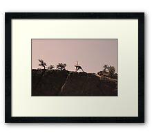 stretching in the desert Framed Print