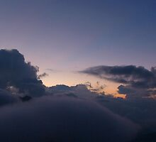 First Hint of Sunrise through Clouds at Poon Hill by SerenaB