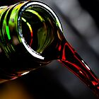 Pouring red wine by Darren Sharp