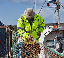 Man At Work-Mending Fishing Nets by lynn carter