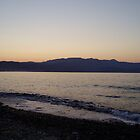 Golden lemon sunset over sea in Crete with lilac mountains  by Grace Johnson