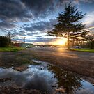 Sunset & Puddle Reflections  by Yhun Suarez