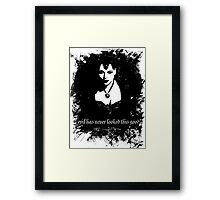 Evil has never looked this good. Framed Print