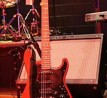 Red Guitar During Concert by anneharpen