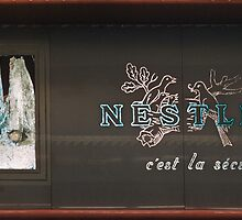 Nestle sign Franklin Roosevelt Metro station  1957 09190004  by Fred Mitchell