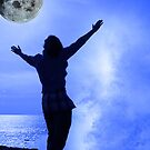 a woman with raised hands facing a wave and full moon on cliff edge by morrbyte