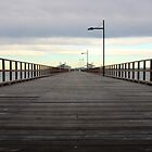 Along the pier by William Goschnick