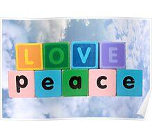 love on peace in wood play block letters against clouds Poster