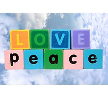 love on peace in wood play block letters against clouds Photographic Print
