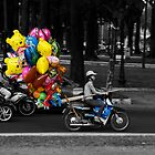 Balloons on a bike by Paul Knowles