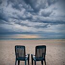 Sunrise on the Beach with Two Chairs at Oscoda Michigan by Randall Nyhof