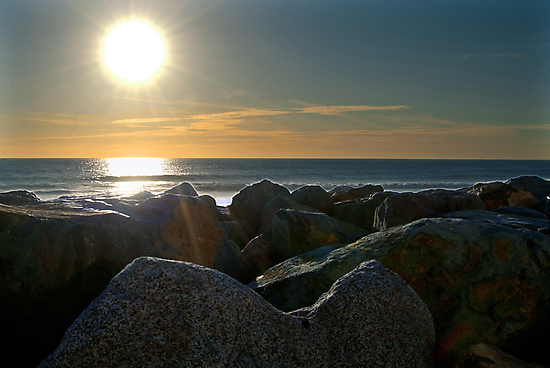 Sunset on the rocks by Phil Campus