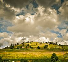 Clouds and a Hill by wulfman65