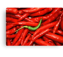 Green on red Chilli. Canvas Print