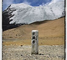 Tibet mountain peak with road marker by derek blackham