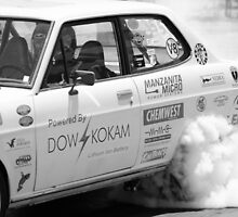 Black & White Datsun Smoking Tires on Race Track by msqrd2
