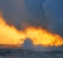 Steam rising off lava flowing into ocean at sunset by Sami Sarkis