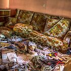 Trashed and a couch by Randy Turnbow