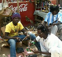 WOOD CARVERS IN SENEGAMBIA CRAFT MARKET by Rosetta Jallow