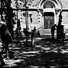 Couple kissing at the square by Miquel  Gil
