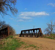 Kansas Country Bridge with Blue sky by ROBERTDBROZEK