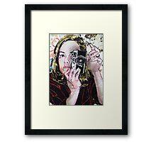 Girl takes polaroid Framed Print