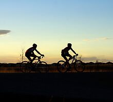 Bikers at sunset by Klaus Girk