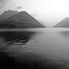 morning haze on Lake Lugano from Lugano Paradiso by bartfrancois
