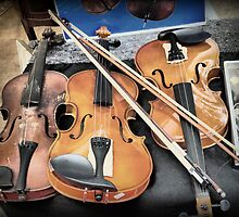 A Day in Levallois Perret (4)  Violins waiting for a new home. by Larry Lingard-Davis