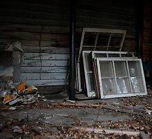 Pile of window panes by ashley hutchinson