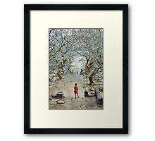 Girl amoungst the trees in Wat Phu, Laos. Framed Print