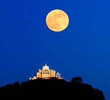Greek island chapel under fullmoon twilight by shelfpublisher
