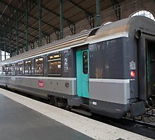 SNCF train at Gare Du Nord Station in Paris, France. by Keith Larby