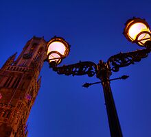 The Bell Tower and a lamp at night in Bruges, Belgium by Elana Bailey