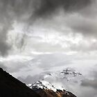 Snowy Mount Everest shines through the clouds by ieatstars