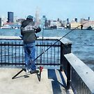 Man Fishing Off Hoboken Pier by Susan Savad
