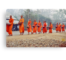 Morning monks line up. Canvas Print
