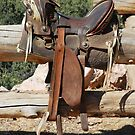 Saddle on Ranch Fence  by Robert Meyers-Lussier