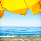 Yellow Sun Shade and Blue Sky by eyeshoot