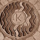 Squiggles and Hay with a K Manhole by Mary-Elizabeth Kadlub