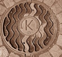 Squiggles and Hay with a K Manhole by M-EK