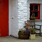 At the cottage door by Agnes McGuinness